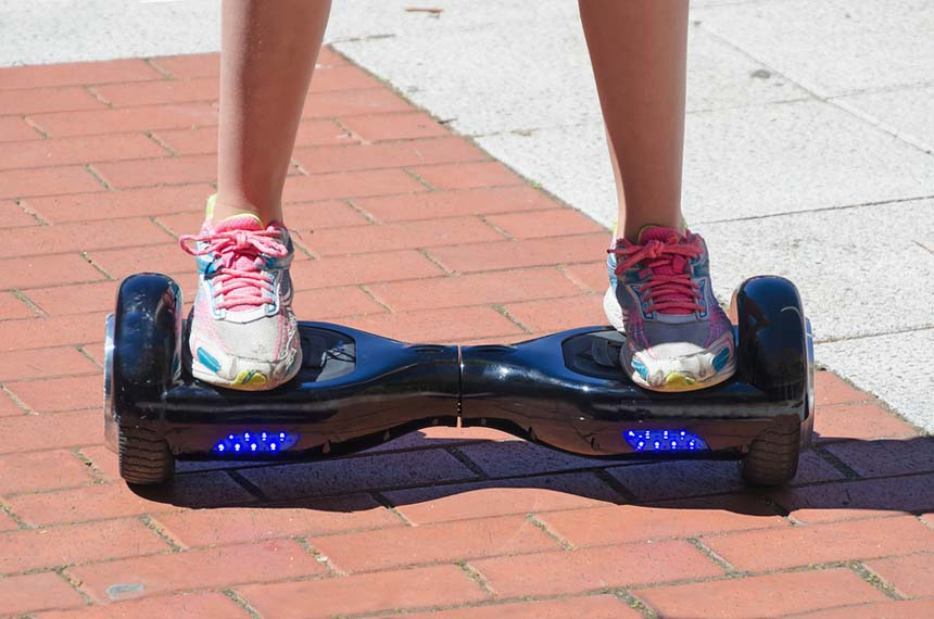 A Girl Riding A Self Balancing Board Gyroscooter